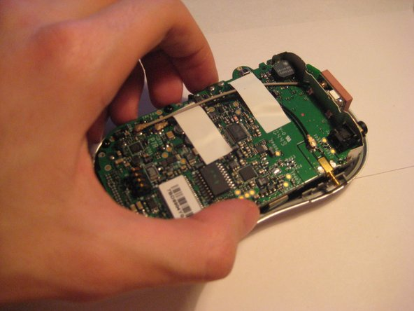 With the screws and the two external pieces removed, the PCB Logic Board can be removed from the front piece.