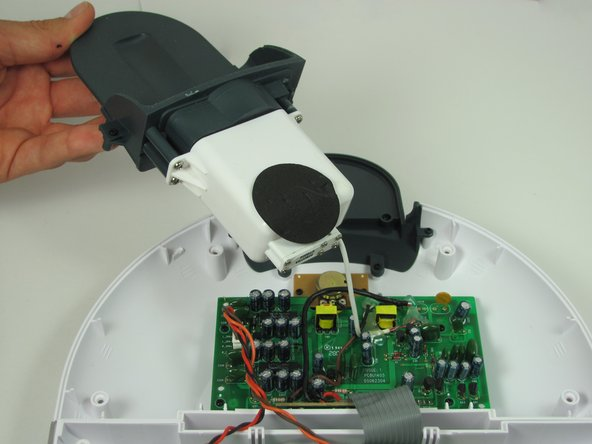 Image 1/2: The Zipconnect unit will lift out but will still be attached by a wire connected to the motherboard.