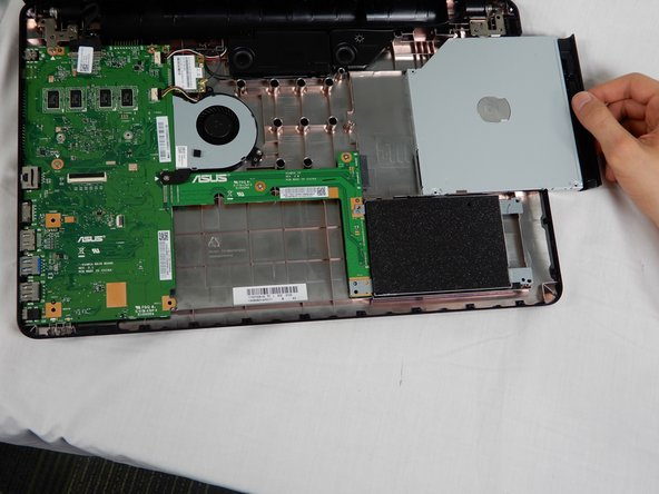 Slide the disc drive to the right, removing it from the laptop case.
