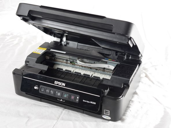 Before beginning, make sure the printer is unplugged and turned off to avoid electric shock.