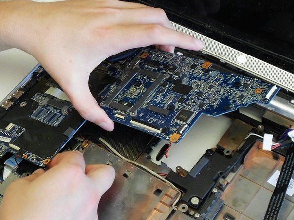 Image 3/3: CAUTION: Be careful not to bend or break the motherboard body or USB ports.