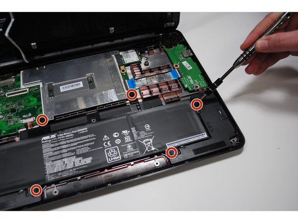 Remove the 6.0mm Philips screws from around the battery.