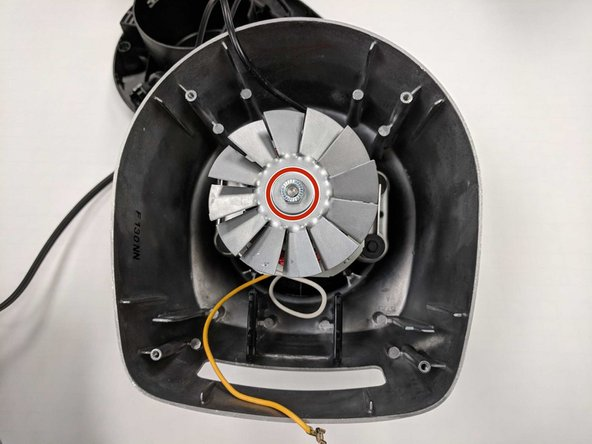 Remove the screw on top of the fan  with the 4mm socket stock wrench.