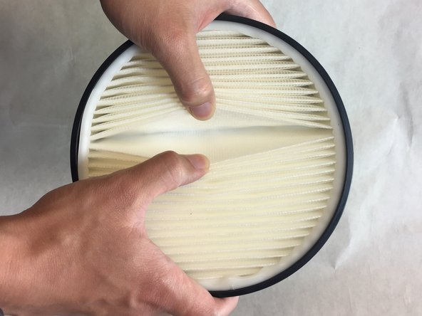 Gently pull apart each fold of the filter to check for abrasions or other anomalies.  Clean with a dust rag if necessary.