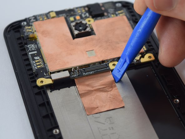 Using a plastic opening tool, lift the copper sheet heat strip from the body of the phone by sticking the tool into one of the upper corner of the copper sheet and slowly sliding it along the edges.
