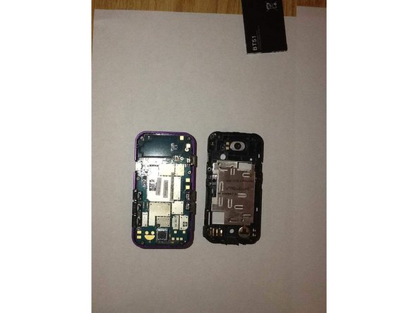 Using the pry tool gently remove the back piece of the phone from the front piece.