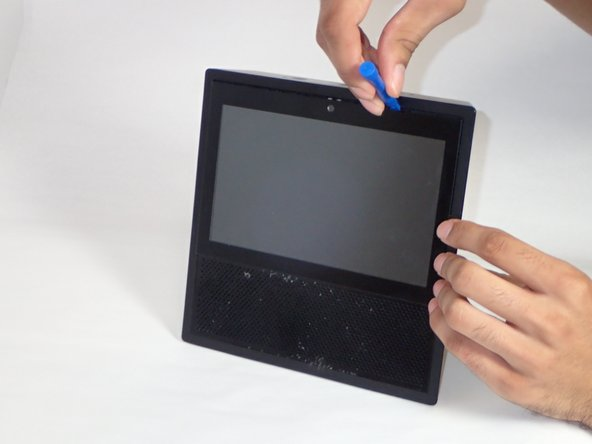 Use the plastic opening tool  to gently lift the plastic protector from screen.