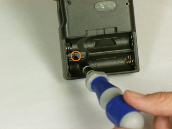 Next, use the same screwdriver to unscrew the (1.7X5 mm) screw, which is located inside the battery compartment.
