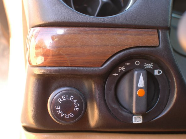 First, at some point someone painted the wood trim around the climate control unit and the center stack switches above it black.