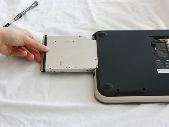 Slide the CD/DVD drive on the side of the laptop out using your fingers.