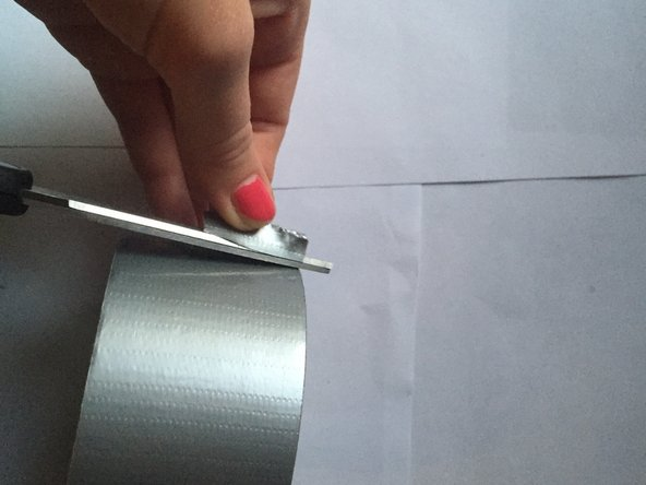 Take your roll of duct tape and cut off a small amount (about as long as the tear)