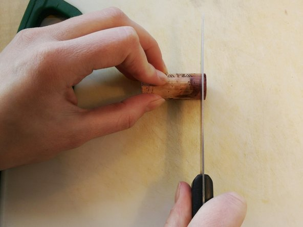 Image 1/2: Cutting corks can be tricky. Make sure to keep fingers out of your knife's way.