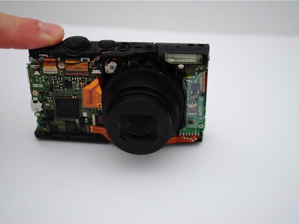 Manually remove the front panel from the camera.
