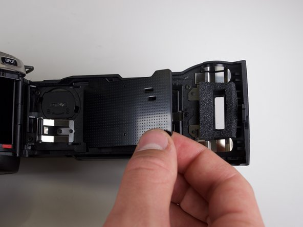 Remove the black case by gently lifting it with your fingers and rotating counterclockwise.