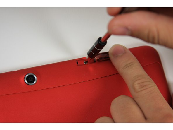 Remove the 5 mm screw using the Phillips PH00 bit in the iFixit metal Screwdriver.