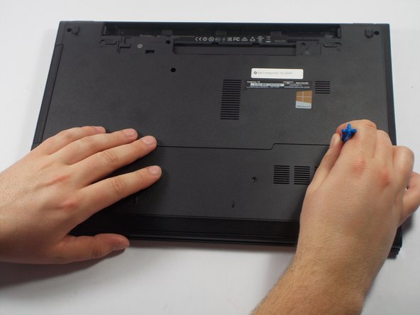 Using a PH0 sized screw driver, carefully remove the 4mm  screw from the bottom cover.