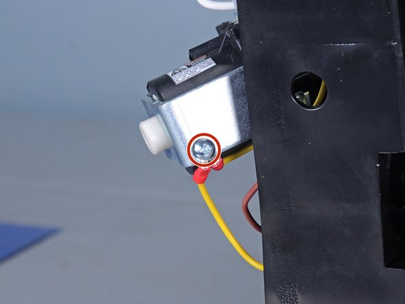 Use a Phillips #2 screwdriver to remove the screw securing the ground wire to the pump.