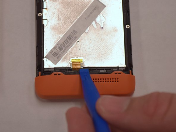 Image 1/1: Lift the battery with the plastic opening tool and finish removing battery by hand.