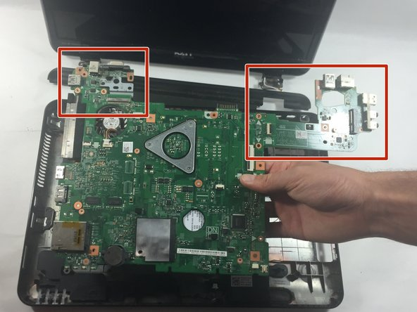 Image 2/3: Flip the system board over revealing the fan compartment and the hard drive.