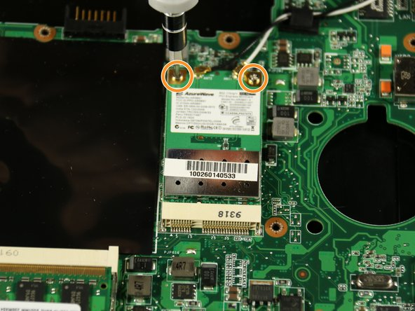 Image 2/3: Use your hand to carefully lift up and remove the wireless network card from its connection to the motherboard.