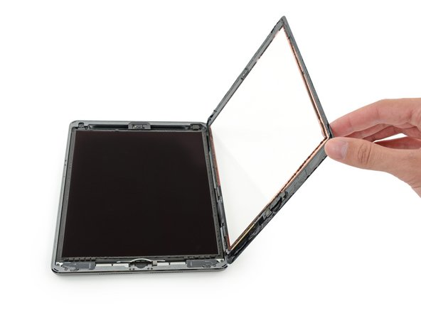 Once all of the adhesive has been separated, open the front glass like a page in a book and rest it on your workspace.