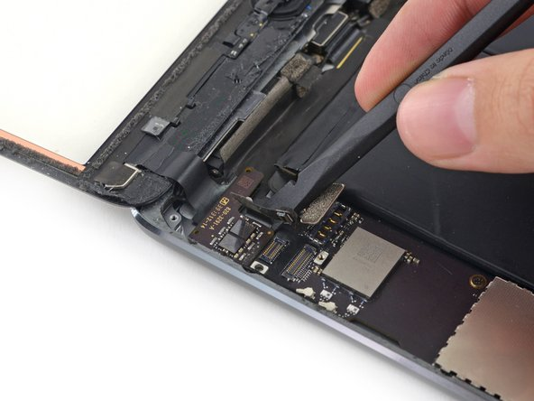 Slide the spudger under the battery side of the digitizer board to begin separating it from the rear case.