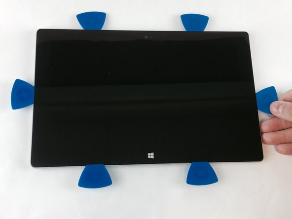 Avoid holding the heat gun too close to the Microsoft Surface 2 so as to not cause any unwanted warping.