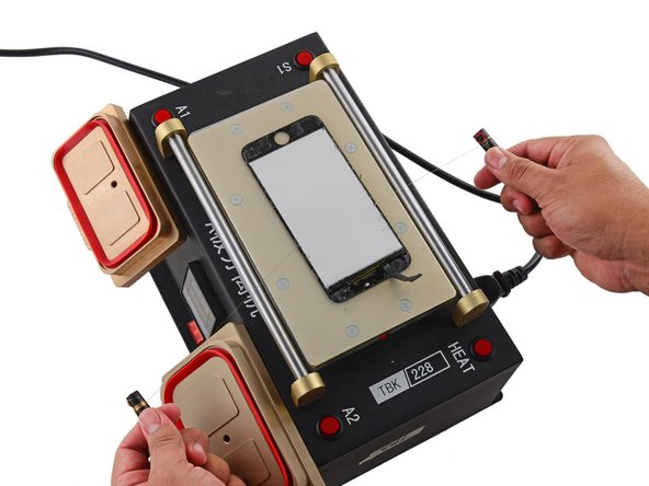 This particular machine uses a vacuum to secure the iPhone's glass to a heated surface. This process helps to weaken the optically clear adhesive (OCA) that secures the glass to the actual display.