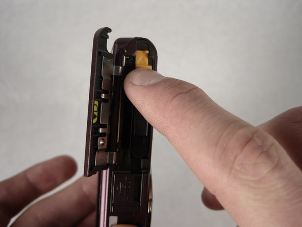 Image 1/2: The battery should pop out.