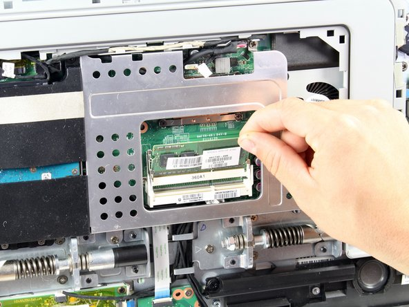 Gently remove the RAM module from the slot.
