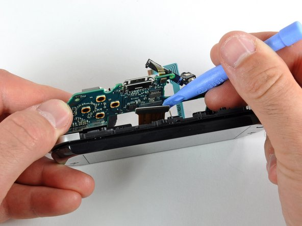 Use a plastic opening tool to disconnect the display cable from the logic board.