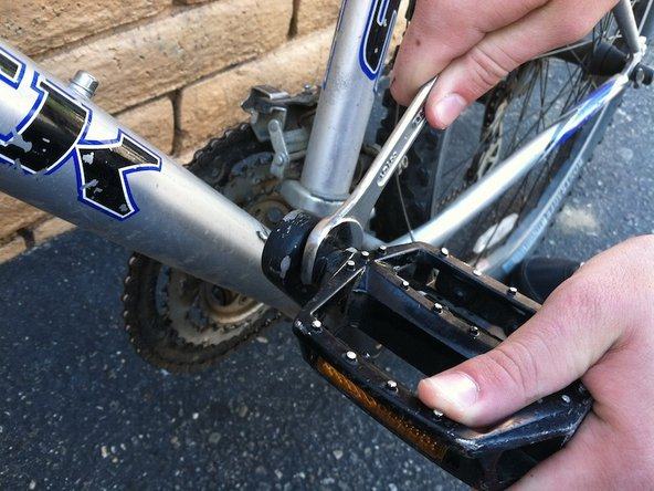 Lock the wrench to the pedal and carefully unscrew it until the pedal comes off.