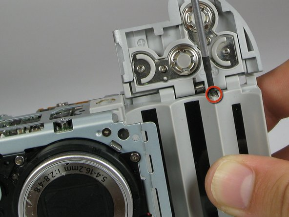 Remove the 4.2mm screw directly under the battery flap.