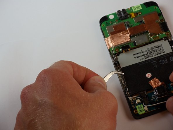 Now locate the coaxial bluetooth cable that connects the top and bottom boards of the phone.