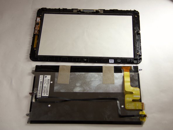 Use a plastic opening  tool to separate the LCD from the digitizer.