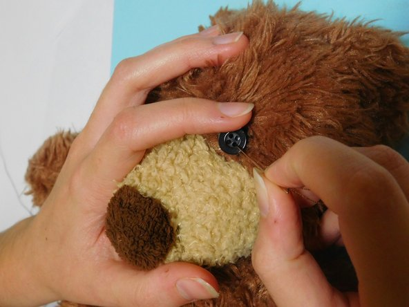 Image 1/1: A Disclaimer: This guide uses the stuffed bear as an example scenario and provides instruction on the proper way to attach a button, but the button will not be attached to the bear in this demonstration.