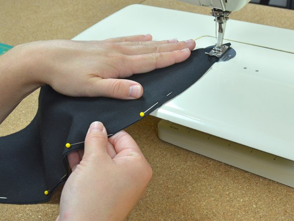 Image 2/3: Keep the fabric aligned to the edge of the presser foot as you sew.