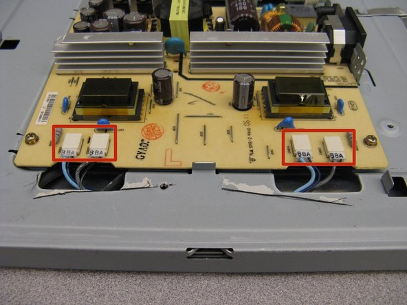 Use the tweezers to remove the four connectors from the power supply board.