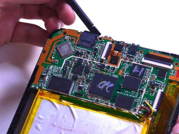 Gently lift the motherboard up to extract the charging port out with the tweezers.
