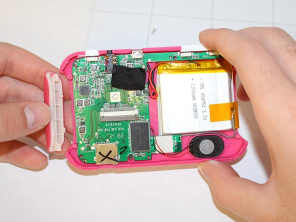 If you need to remove the back part of the casing, after disconnecting the LCD display from the motherboard, remove the screws holding down the motherboard. Remove the plastic power and volume buttons. remove the two side grips of the device.