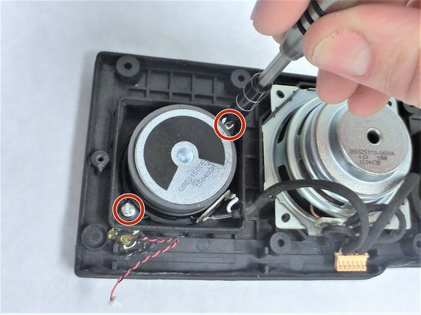 Remove the 6.3 mm screws holding each of the auxiliary speakers into the speaker assembly with Phillips head #2 screw driver.