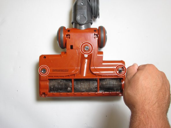 Locate and twist the three plastic screws to the unlock position with a quarter or flathead screwdriver.