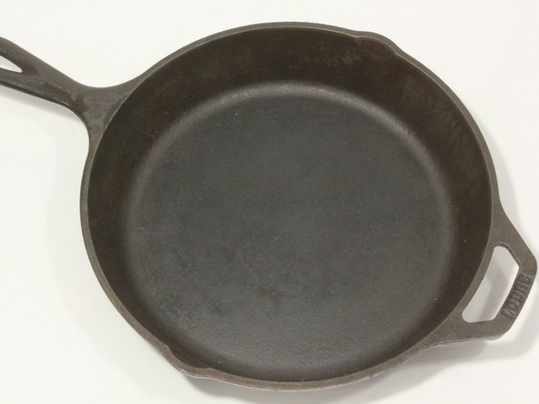 Image 2/2: If there is noticeable rust, continue to step 2. If there is not, and the pan or skillet merely needs to be re-seasoned, then skip to step 4.