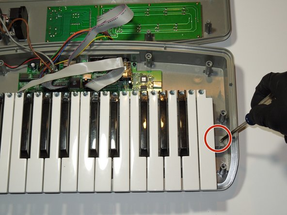 Image 2/2: Remove the key assembly retaining screws, using the J1 head in the Ifixit tool kit