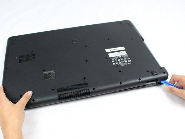 Use the iFixit opening tool to pry open the four corners of the back cover of the laptop.  You may need to use your hands to fully remove the cover.