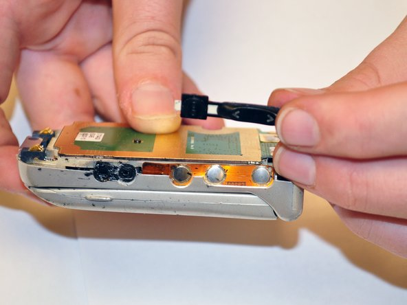 Image 3/3: Use caution in removal to prevent damaging any circuitry in the phone.
