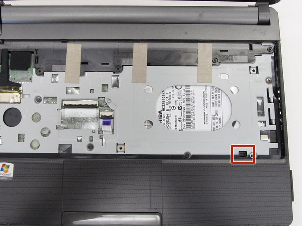 Image 1/3: The tip of the screwdriver will push against the bottom casing of the laptop and pop it away from the rest of the frame.