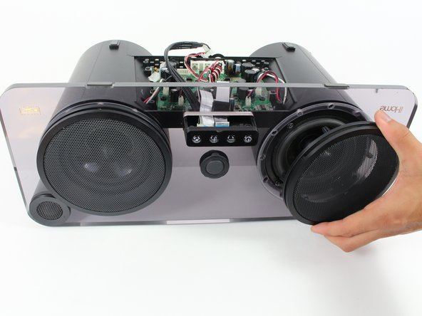 After this step, this guide only shows how  to replace the left speaker. To remove the right speaker, follow the remaining steps as if they are mirrored.