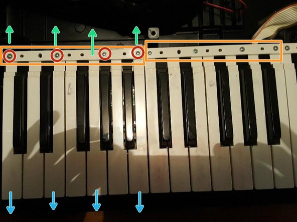 Be sure to hold everything together as you turn the keyboard over. Be especially careful of the ribbon cable going to the left-most side of the keyboard.
