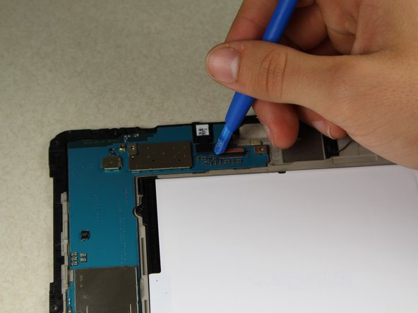 Using the plastic opening tool, continue disconnecting cables on upper motherboard.